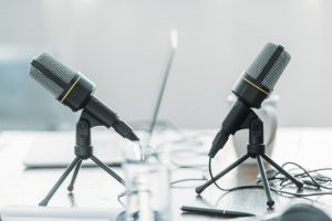 selective focus of two microphones on wooden table in broadcasting studio